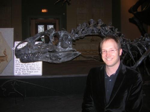 Thomas Carr and his friend, an Allosaurus.