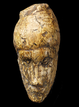 The oldest known portrait of a woman sculpted from mammoth ivory found at Dolní Vestonice, Moravia, Czech Republic. approximately 26,000 years old
