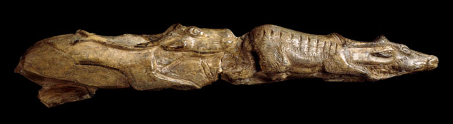 Tip of a mammoth tusk carved as two reindeer depicted one behind the other. Approximately 13,000 years old, from Montastruc, France