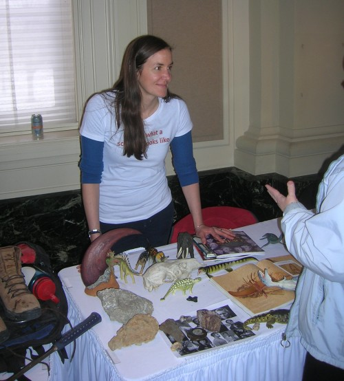 "Dr. Summer Ostrowski talks with a visitor on Women in Science Day. Her shirt reads ""This is what a scientist looks like."""