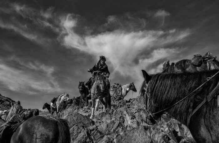 A member of the nomadic horse-riding Kazakh people of Mongolia watches over his horses. (© Palani Mohan, 2014 Sony World Photography Awards)