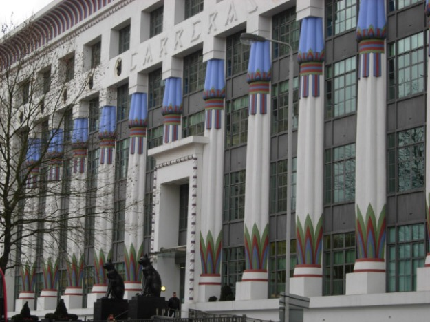 An Art Deco Building In London Guarded By Two Moggies