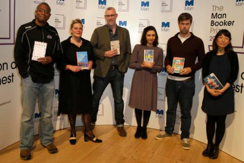"The Man Booker prize short list writers pose for the media, with the books ,they are from the left-Paul Beatty, ""The Sellout"", Deborah Levy , ""Hot Milk"" Graeme Macrae Burnet, ""His Bloody Project"", Ottessa Moshfegh ""Eileen"", David Szalay ""All That Man Is"", and Madeleine Thien, ""Do Not Say We Have Nothing"", during a photocall for the Man Booker Prize for fiction in London, Monday, Oct. 24, 2016. This will be the third year the £50,000 (61,000 US$), prize has been open to any writer, writing originally in English and published in the UK, irrespective of nationality.(AP Photo/Alastair Grant)"